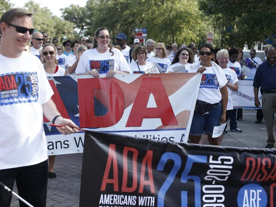 Around 200 people gathered to march along Adams Street downtown, headed to City Hall celebrating the 25th anniversary of the Americans with Disabilities Act on Friday, July 24, 2015.