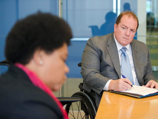 Fred Maahs, a Comcast executive, takes part in a meeting