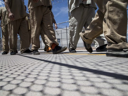Detainees head for lunch from one of the housing units