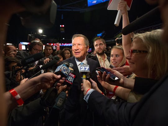 Ohio Gov. John Kasich speaks to members of the media