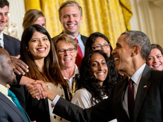 President Barack Obama greets guests in the East Room