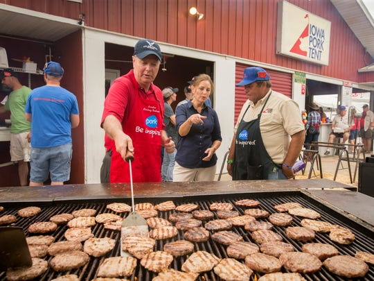 Senator Lindsey Graham flips pork chops while visiting the Iowa Pork Producer's Tent at the Iowa State Fair in Des Moines, Iowa, Monday, Aug. 17, 2015.