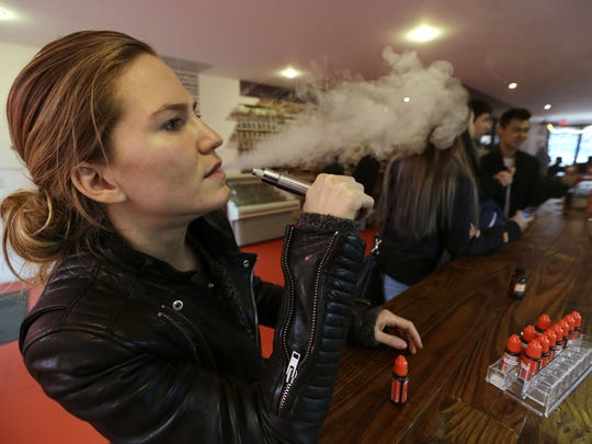 Talia Eisenberg, co-founder of the Henley Vaporium, uses her vaping device in New York in this file photo.