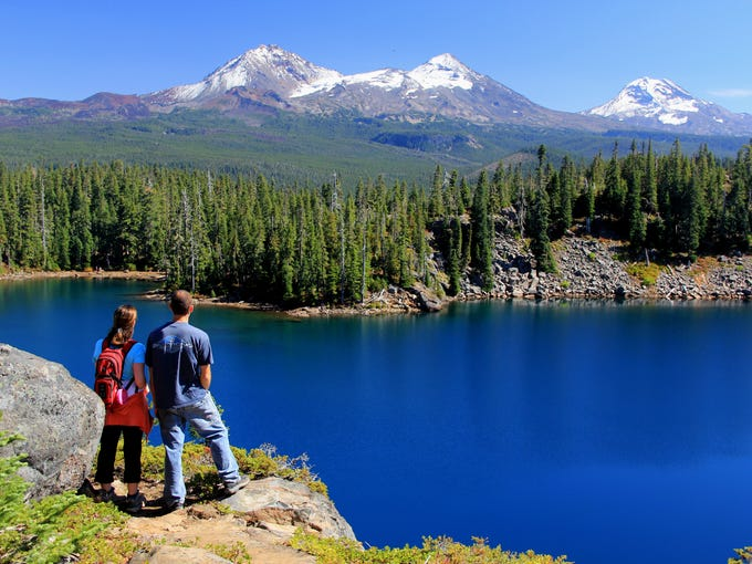 The view of the Three Sisters above Benson Lake, in