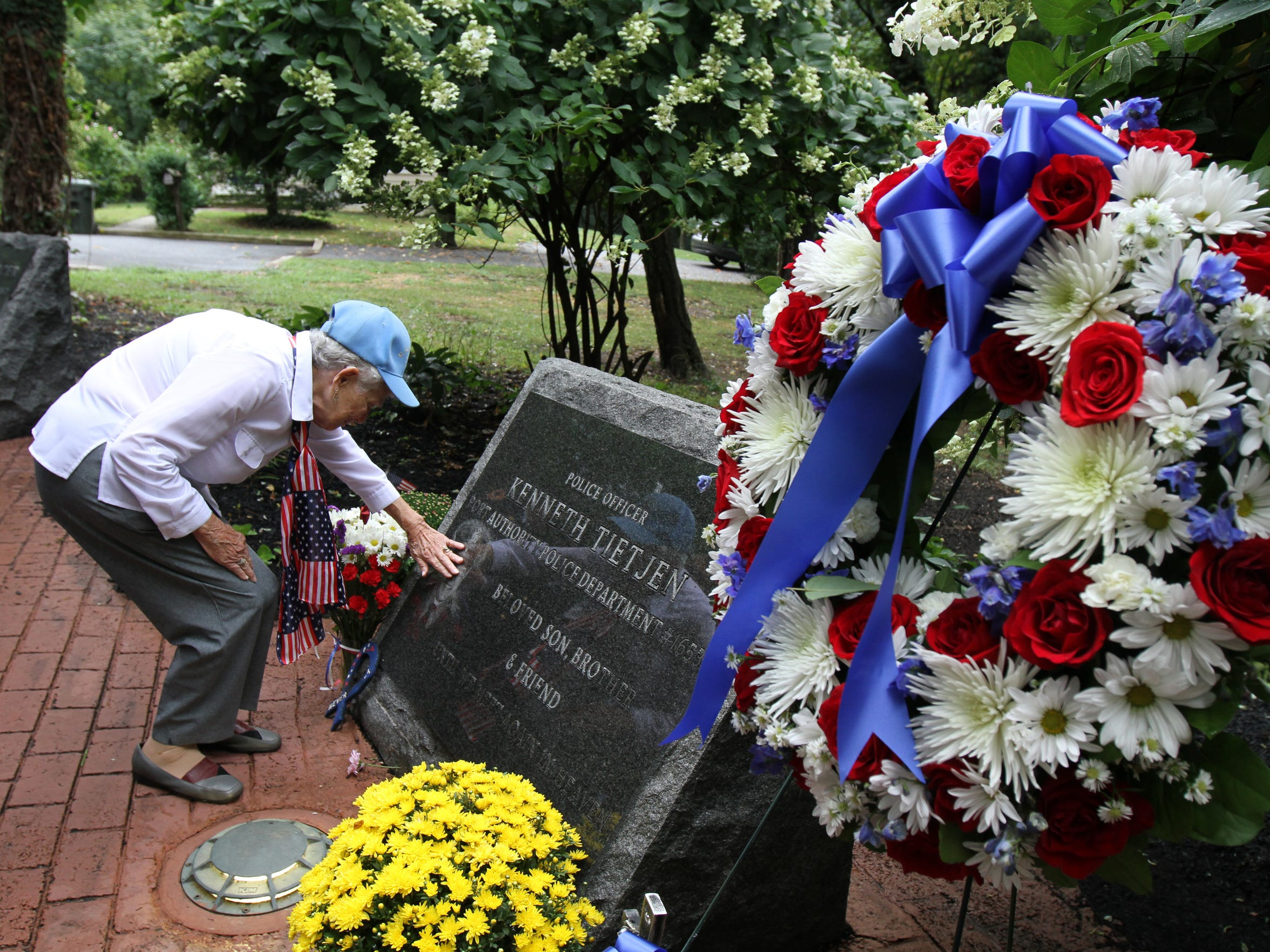 Marge Kempson of Little Silver stops to remember fallen