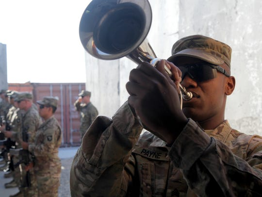 A 3rd BCT, 101st Airborne Division service member plays