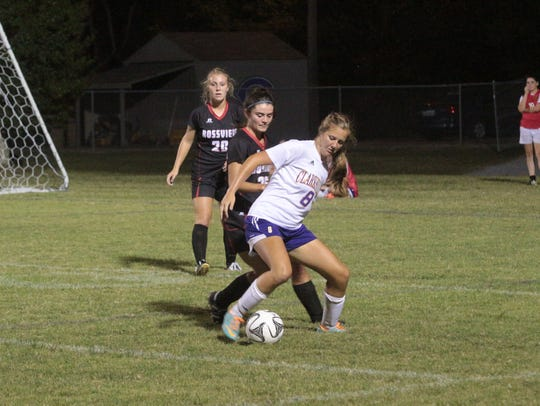 Clarksville High's Kelsey Greiff (8) tries to keep