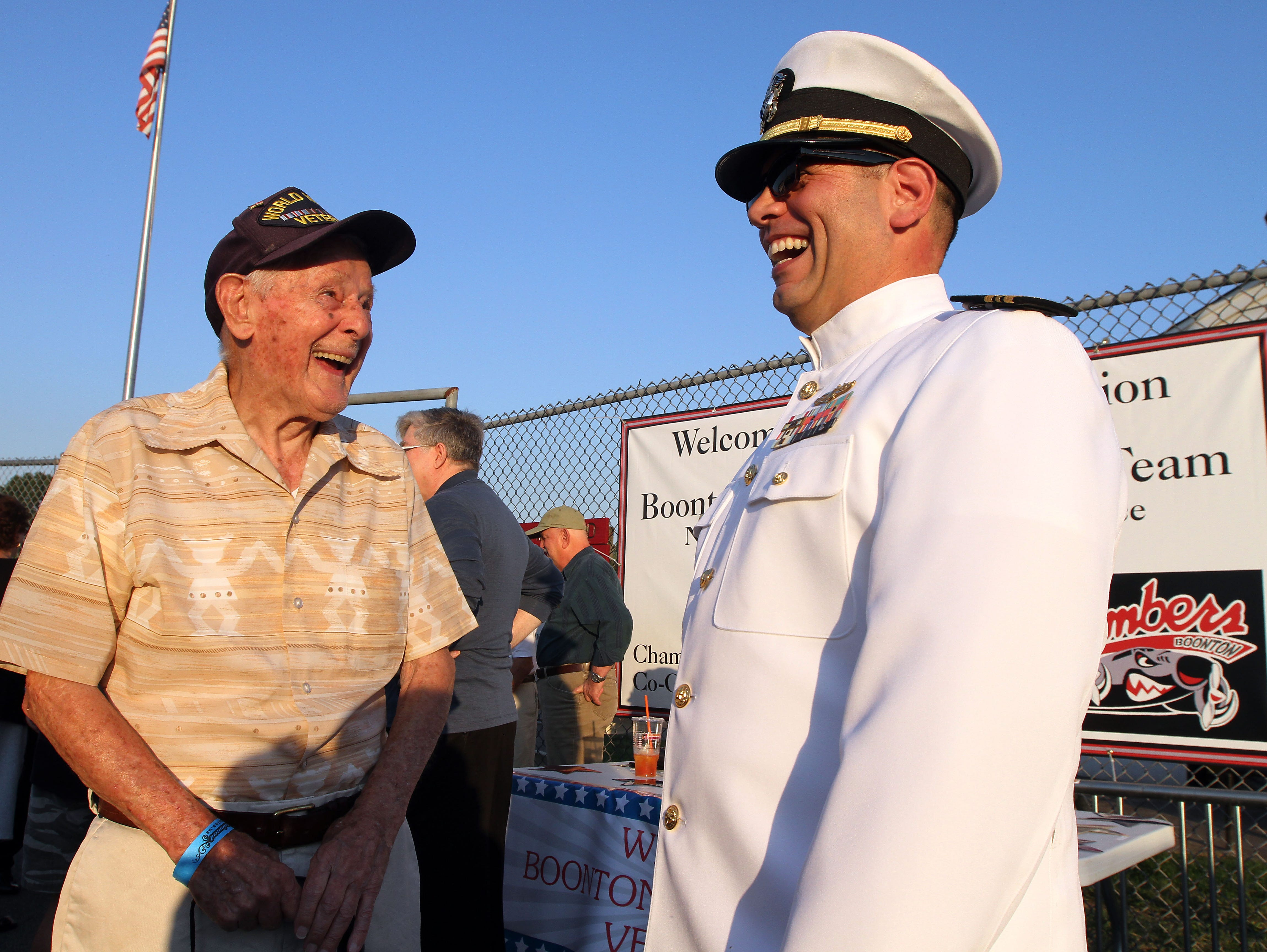 98-year-old World War II Air Force Veteran Steve Bolcar and Navy LCDR. Dennis Maida share a laugh before the Boonton vs Pequannock Friday night football matchup. Boonton High School honored its graduate military veterans during halftime. September 18, 2015, Boonton, NJ.