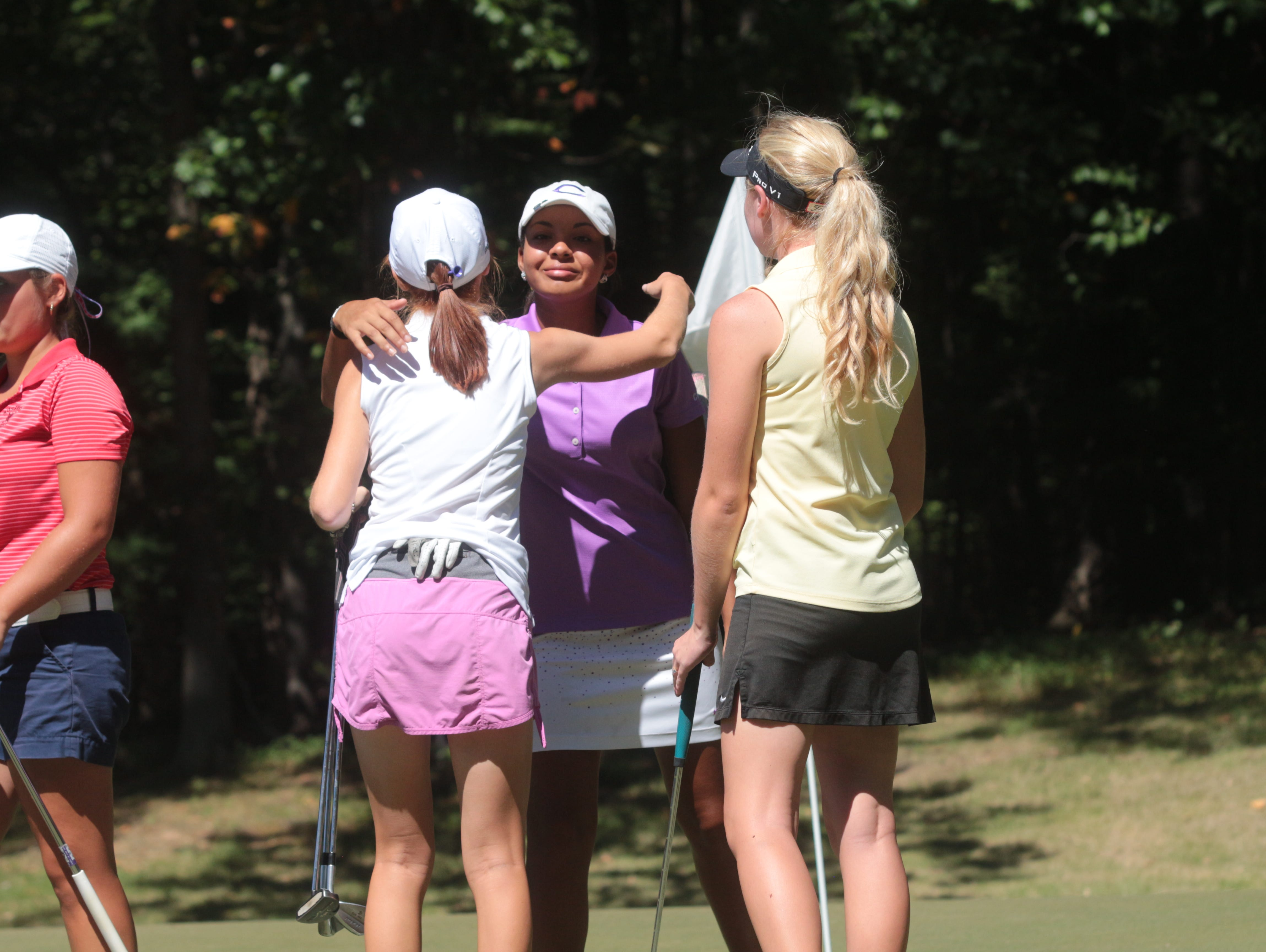 Clarksville High's Mariah Smith, center, congratulates her opponents, including Rossview's Caroline Caudill, left, after the final hole of the Region 5 golf tournament Monday at Swan Lake.