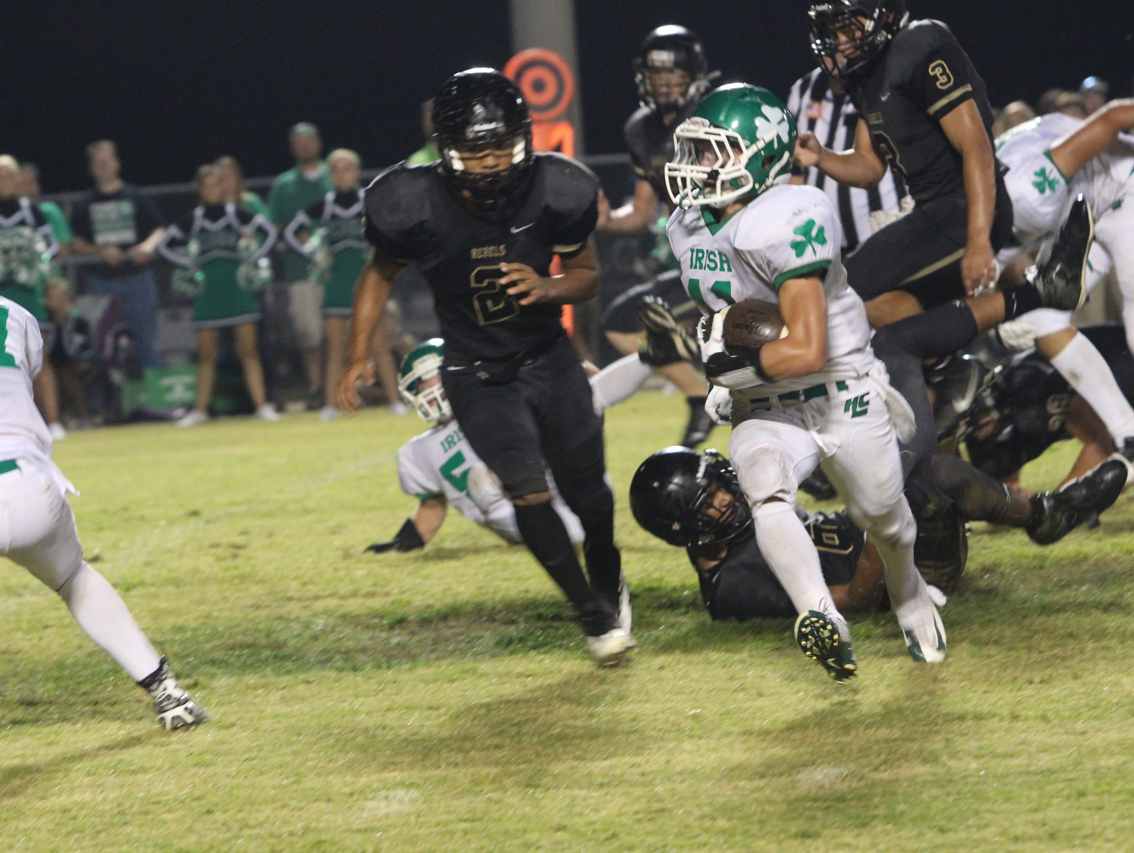 Houston County's Nolas Seay runs around the left end for a touchdown against rival Stewart County earlier this season. The Fighting Irish are ranked No. 10 in the state in Class A and are 5-0.