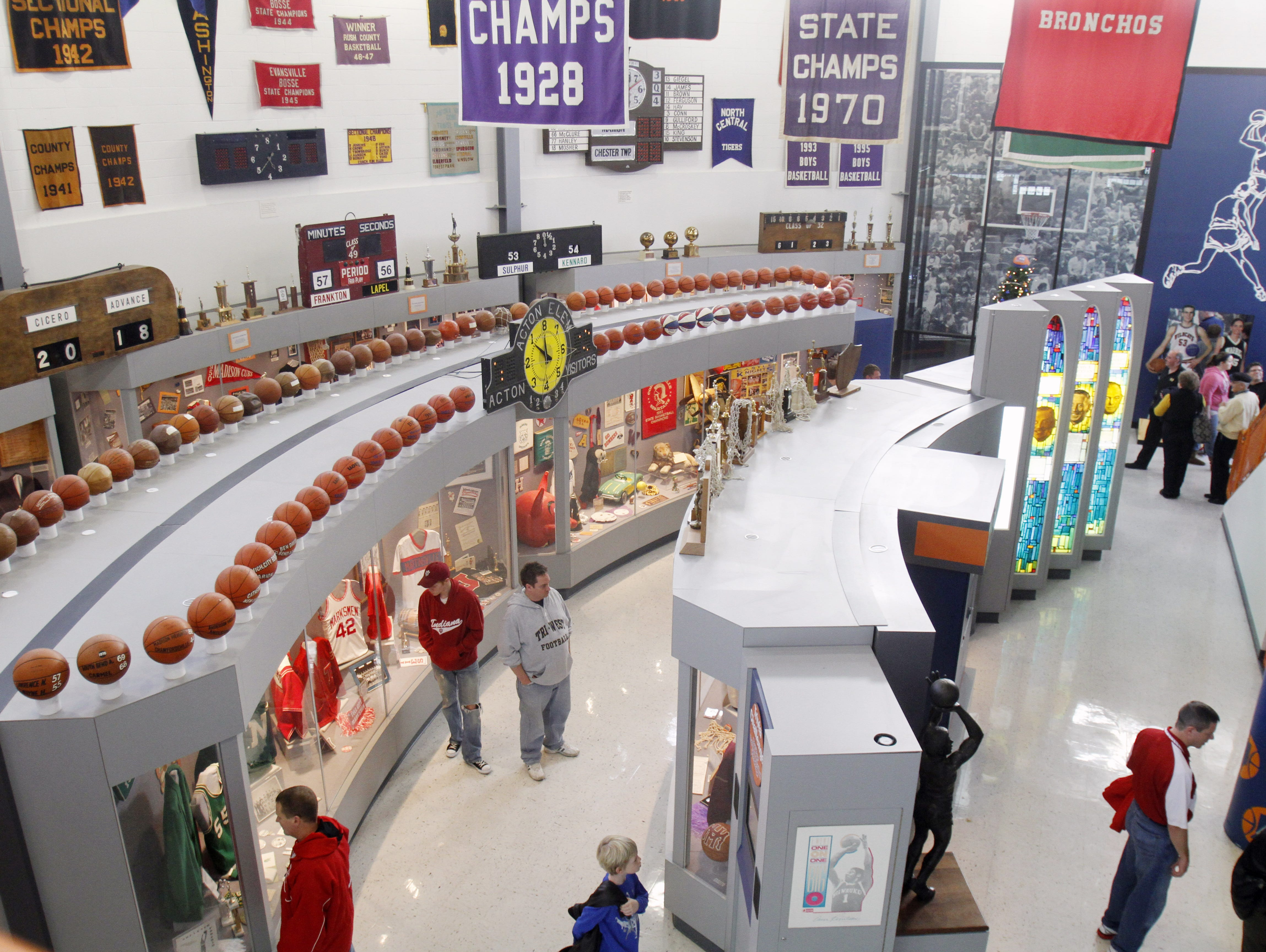 FILE -- Visitors check out exhibits at the Indiana Basketball Hall of Fame in New Castle.