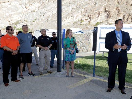 El Paso City Manager Tommy Gonzalez, right, addresses