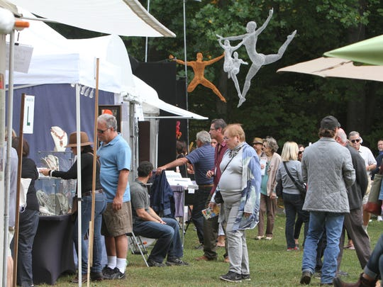 People enjoy the many exhibits and displays at the