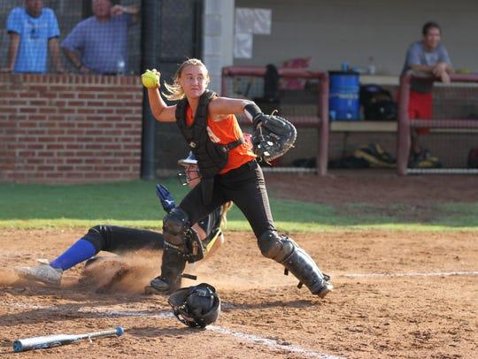 Lauren sets to throw the ball in last summer's Queen