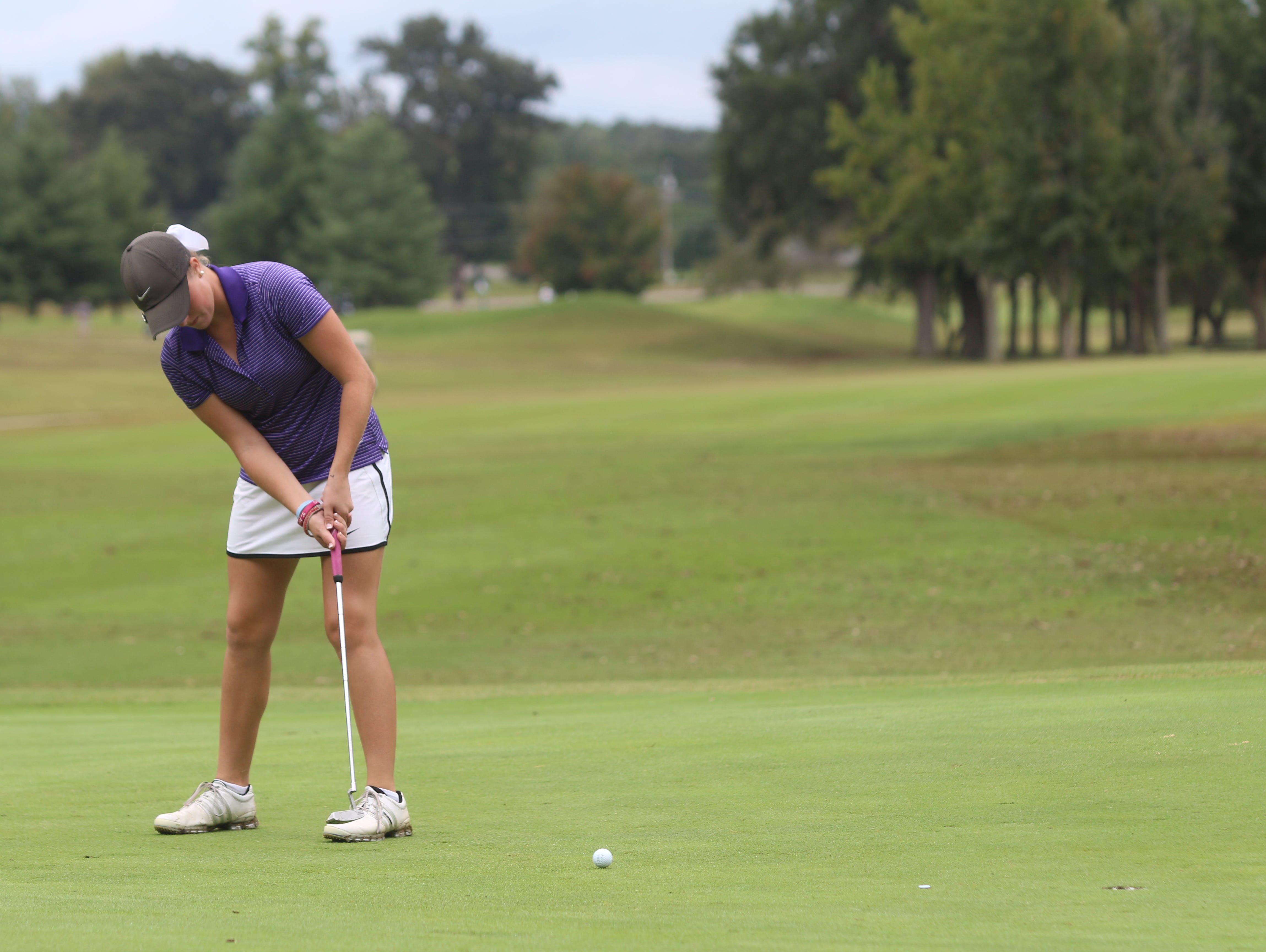 Clarksville High's Riley Cooper connects on a putt on the 13th green during the final round of the girls' Class 3A state golf tournament at WillowBrook Golf Course in Manchester.