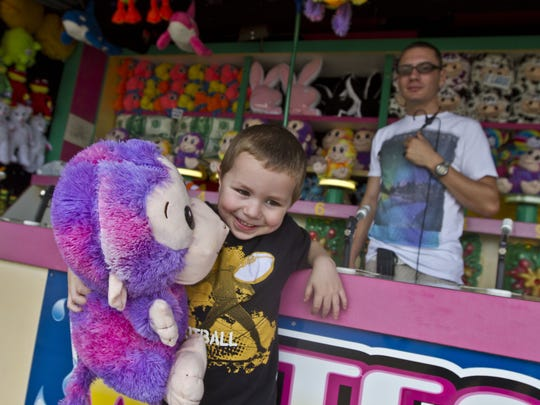 Nicholas Schaffner, 3, of Jackson, is happy to have