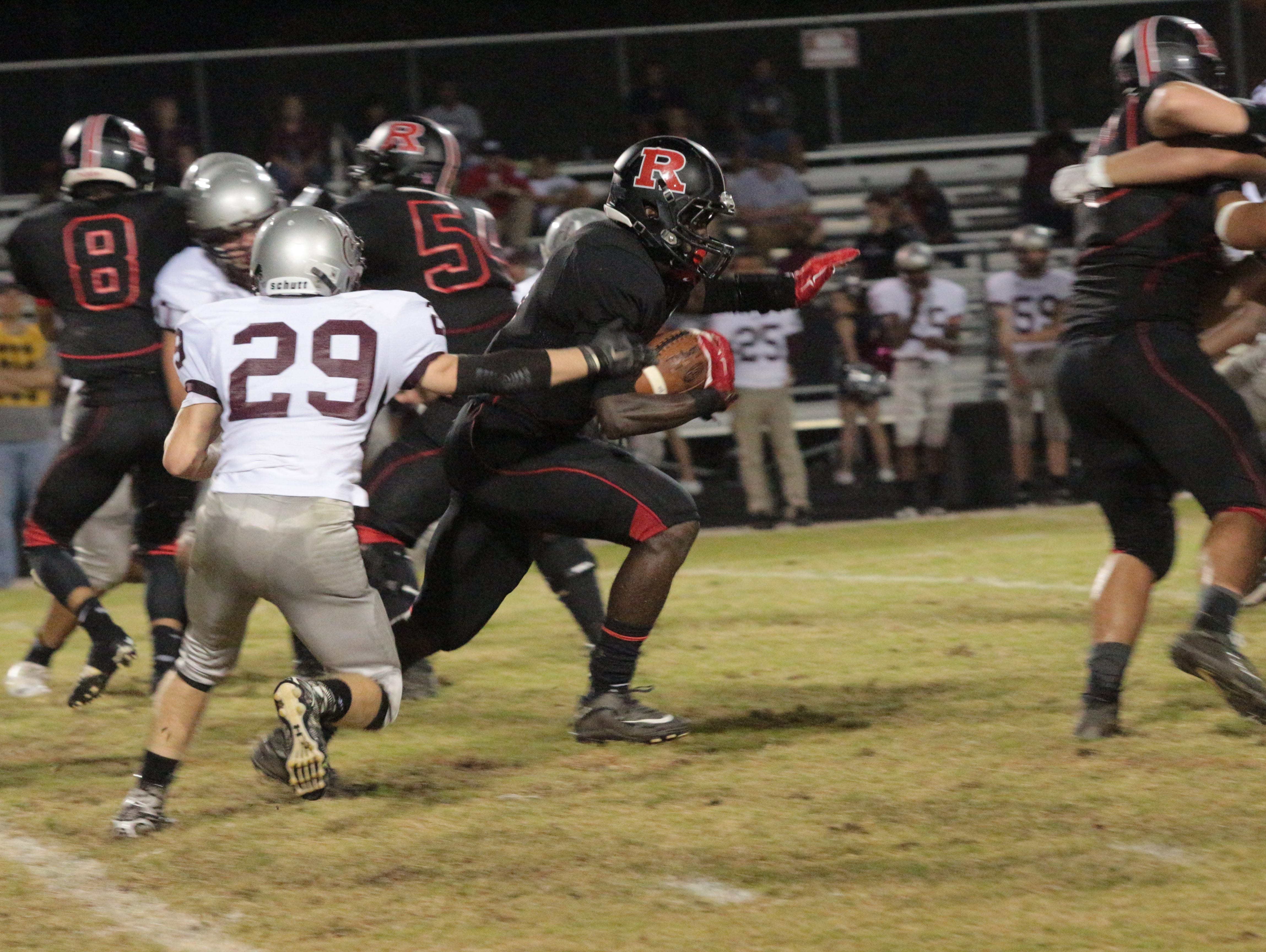 Rossview's KeyShawn McClendon runs for 13 yards on his way to a 131-yard, two TD rushing night as the Hawks dropped West Creek 41-0 Thursday at Rossview High School