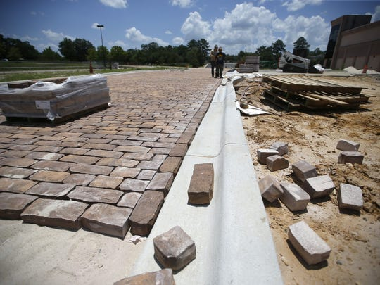 New cobblestone streets are layed, part of the new outdoor design of the Centre of Tallahassee, on Tuesday, June 16, 2015.