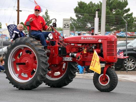 New Mexico Vintage Iron showcased a convoy of historical farm machinery, inlcuding the latest in tractors during the fair
