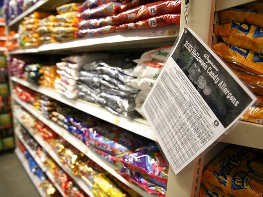 Wegmans has posted signs in the candy aisle to help customers understand the food allergens in many different types of candies.