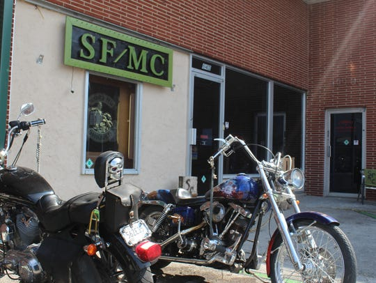 Motorcycles are parked outside the Subdued Few Motorcycle