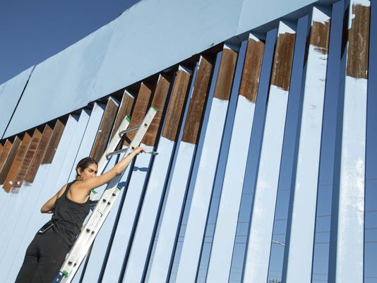 "Artist ""erases"" the border"