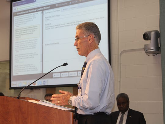 Jim Connell, chief of construction and facilities, presents a five-year work plan during a School Board meeting.