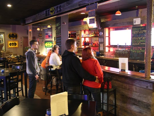 From left, Matthew Clark, Larry and Kelly Blanco, John Gamble and Erin Donnithorne order drinks at Heroes Tap House in South Salem.