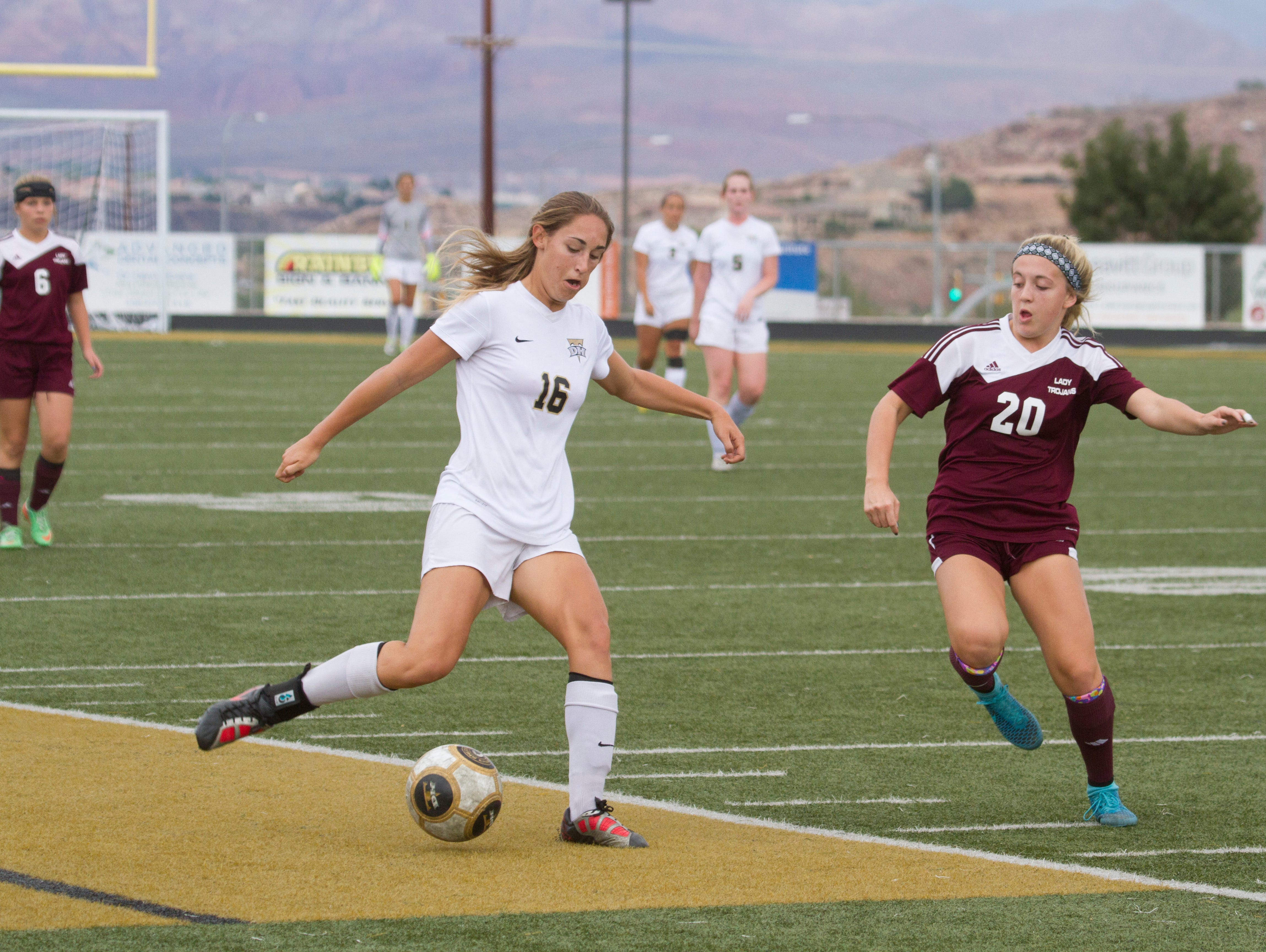 Desert Hills midfielder Kenzie Done centers the ball during their game against Morgan High Saturday, Oct. 17, 2015.