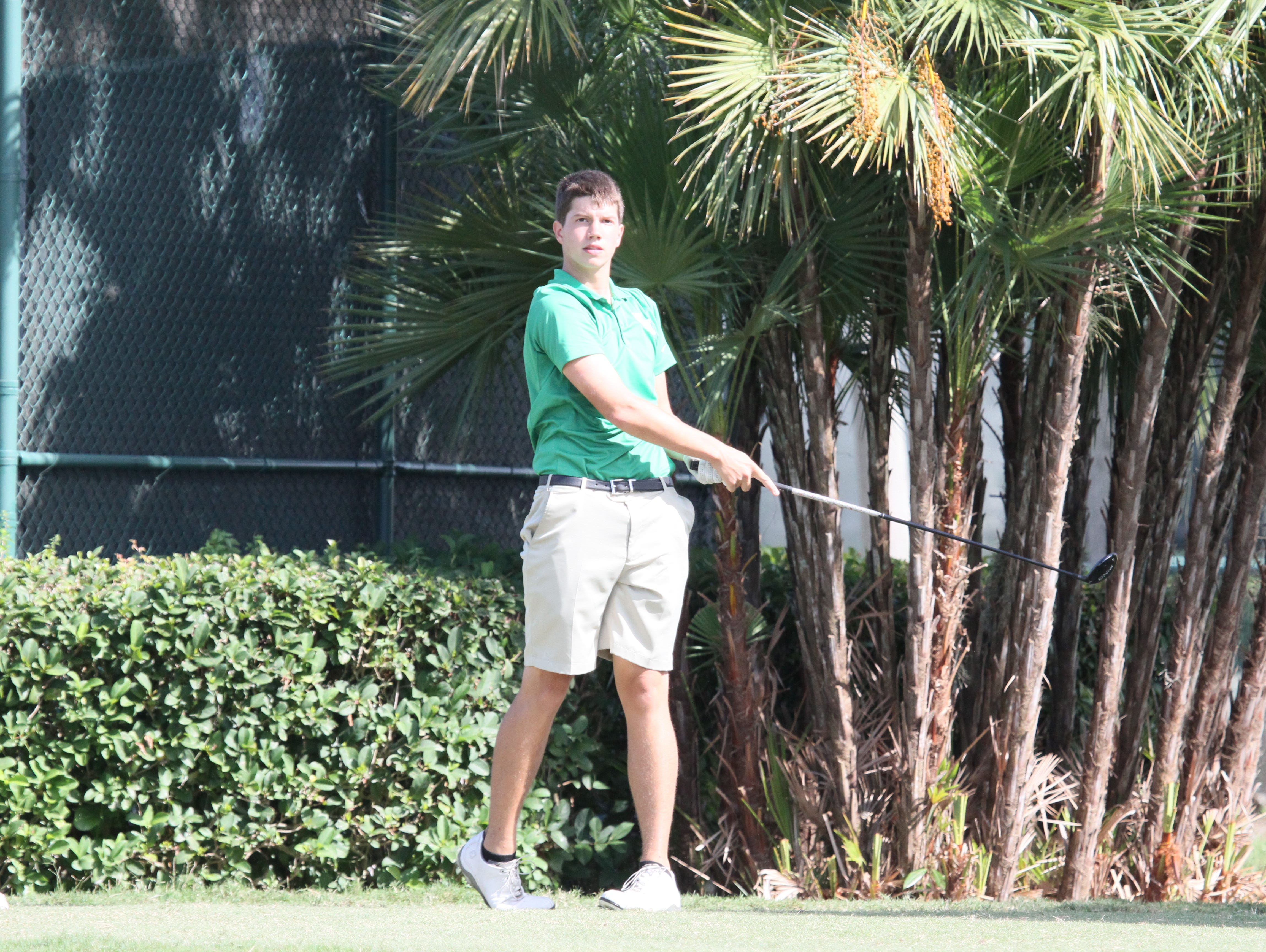 Josh Mesmer of Fort Myers competes in the Class 3A-Region 5 boys golf tournament Monday at Heritage Oaks Golf and Country Club.
