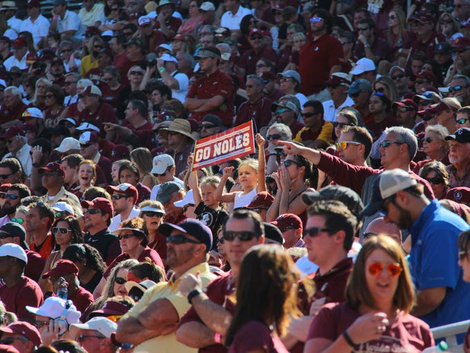 Fans cheer on the Florida State Seminoles during their