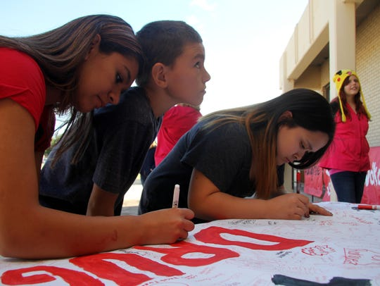 Eighth graders signed a drug-free pledge before walking.