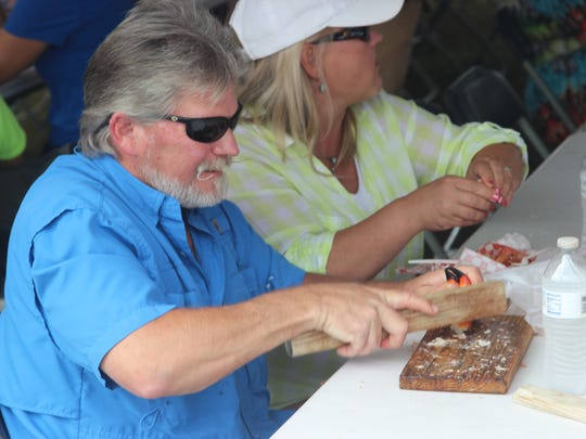 The sounds of mallets hitting stone crab claws filled the air at the 18th annual St. Marks Stone Crab Festival Saturday.