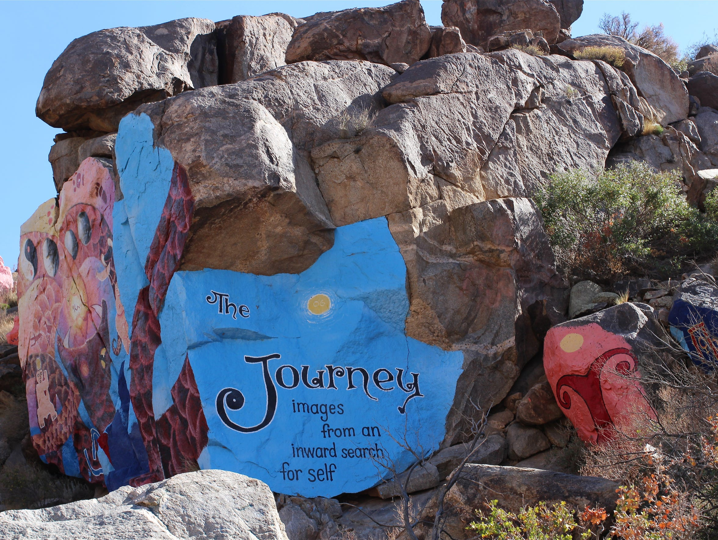 Roy Purcell's rock murals have kept the ghost town