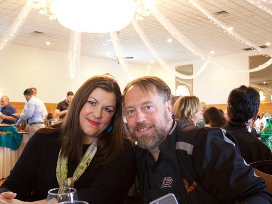 Catherine Whitley and husband Andrew smiled following her presentation at GRACEful Hope's 4th Annual Benefit for Ovarian Cancer in Elizabeth on Oct. 25, 10 days after having elective surgery to reduce her risk of breast cancer.