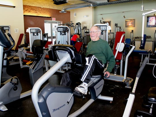 Ken Flanagan of Marshfield works out on an exercise