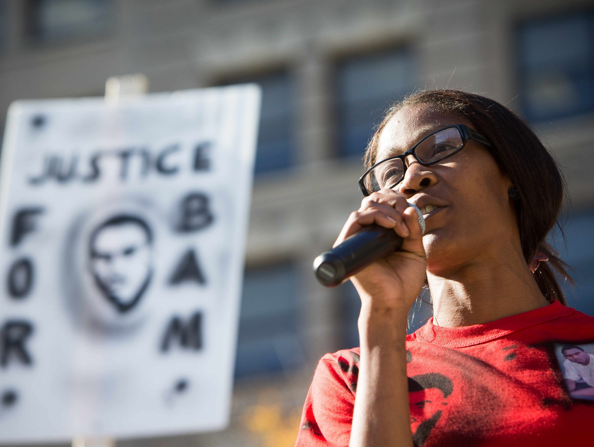 Keandra McDole, Jeremy McDole's sister, speaks at a