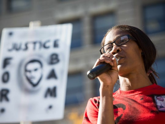 Keandra McDole, Jeremy McDole's sister, speaks at a rally in Rodney Square in Wilmington on Friday.