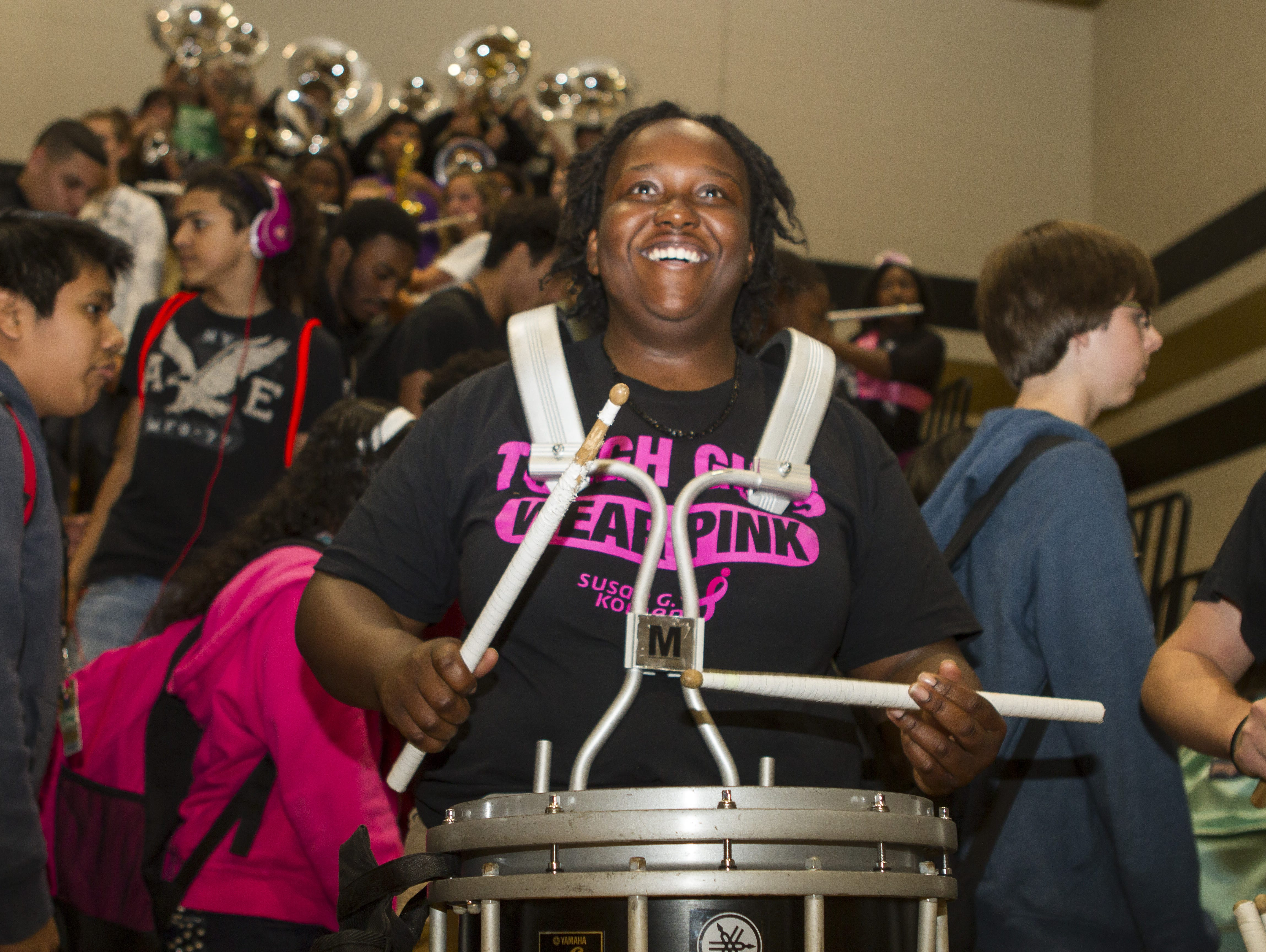 Chasity Holly, 17, and the rest of the Greer High School band play the students out to the parking lot following the pep rally.