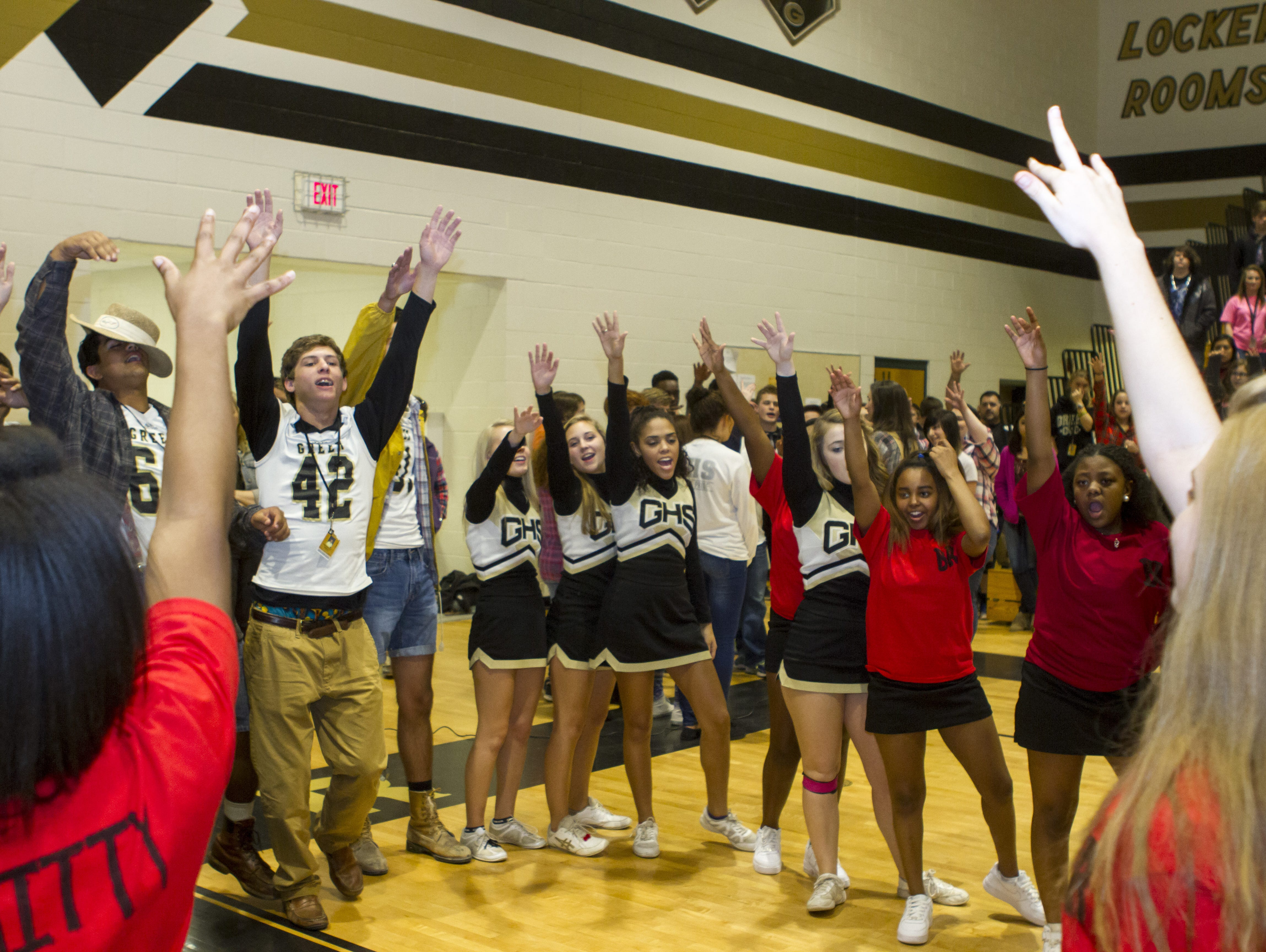 Greer High School football players and cheerleaders come together to sing the school song at a pep rally before the team played Blue Ridge High School. The Yellowjackets defeated the Tigers 32-7.