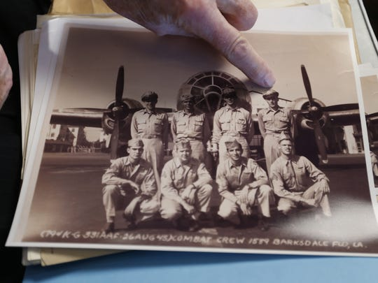 World War II veteran Art Cross points himself out in a photo of his Army Air Corps squad members Wednesday, Nov. 5, 2015, at the Deerfield retirement community in Urbandale.
