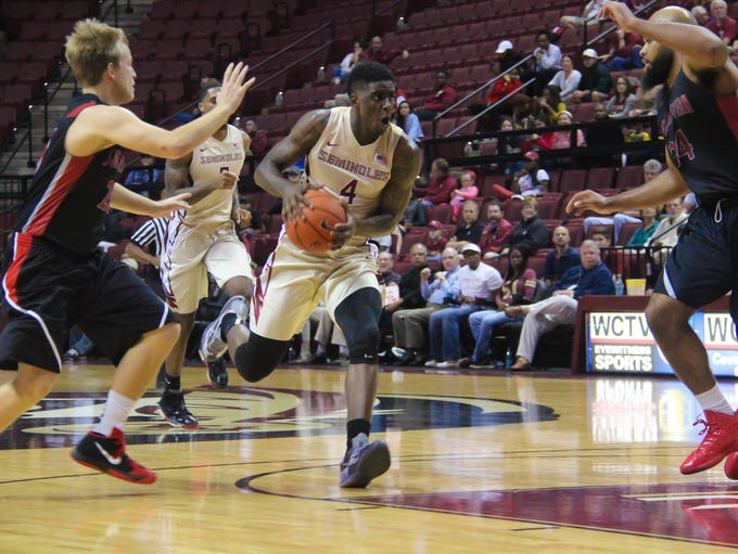Dwayne Bacon (4) drives in for a lay-up. The Seminoles