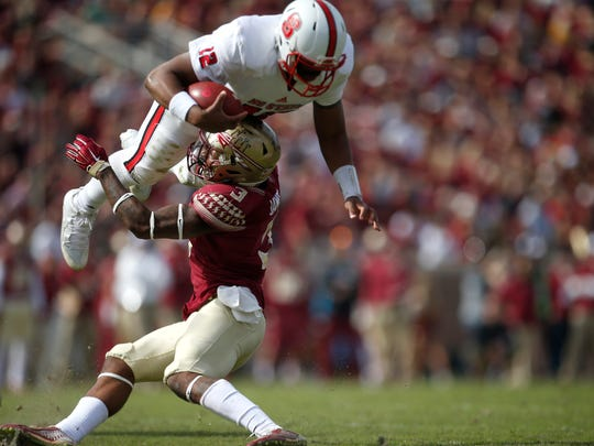 FSU's Derwin James tackles NC State quarterback Jacoby Brissett during their game at Doak Campbell Stadium on Saturday.