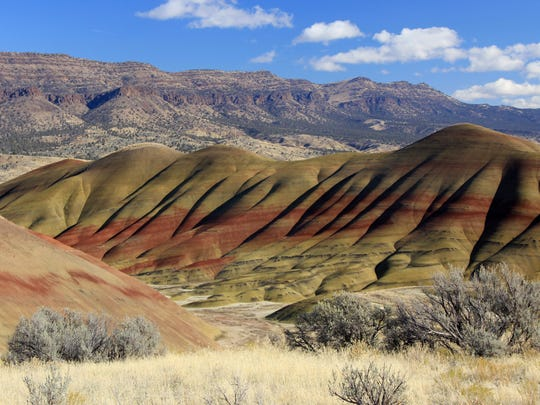 A view of the Painted Hills, a unit of the John Day Fossil Bed National Monument, with Sutton Mountain in the background, in Eastern Oregon.