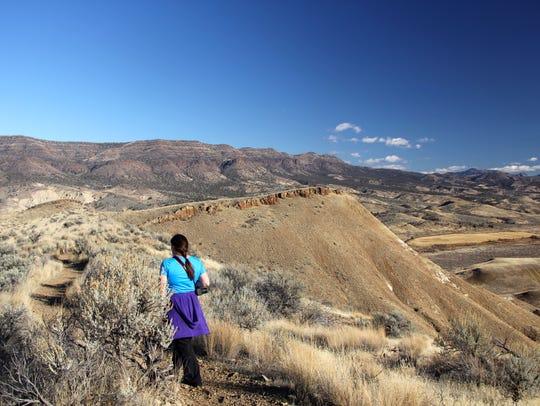 Rachel Housley of Medford hikes down the Carroll Rim