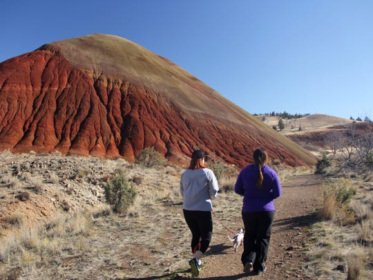 Hikers walk the Red Scar Knoll Trail in the Painted