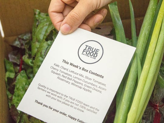 A True Food box contains seasonal fresh vegetables