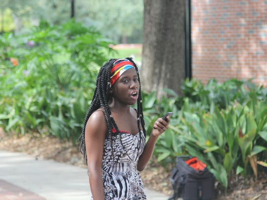 """""""We realize that students can fight oppression. What we're fighting against at Florida State and what we're fighting against at University of Missouri is not something that's only happening on our college campuses. Racism is happening everywhere."""" Regina Joseph Lead Organizer, Students for a Democratic Society"""