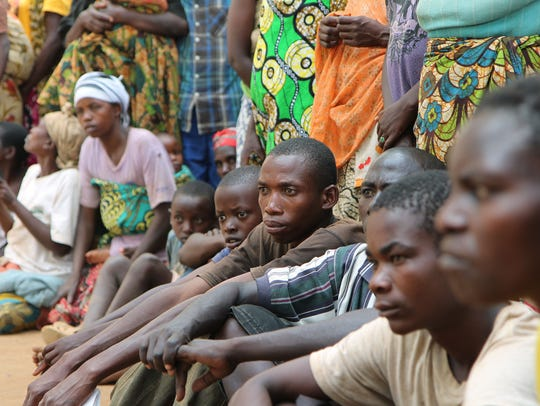 A group of Burundian refugees waits for a soap and