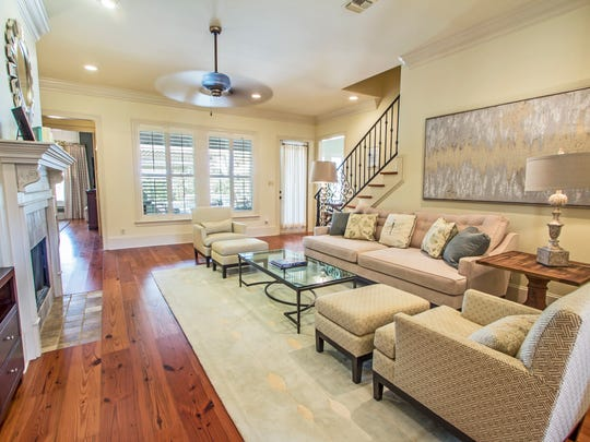 The living area boasts gorgeous wood flooring and natural soothing tomes, throughout.